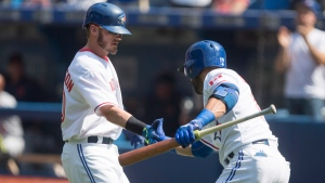 Toronto Blue Jays Josh Donaldson (left)is congratulated by Jose Bautista after hitting a solo home run off Detroit Tigers starting pitcher Alfredo Simon during first inning Major League baseball action in Toronto on Sunday, August 30, 2015. THE CANADIAN PRESS/Chris Young