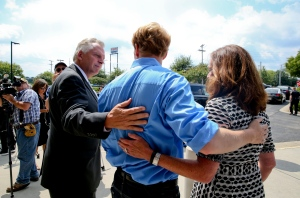 Virginia Gov. Terry McAuliffe, left, and his wife, Dorothy, right, visit with Chris Hurst, boyfriend of slain WDBJ-TV journalist Alison Parker, Friday, Aug. 28, 2015, in Roanoke, Va. (Stephanie Klein-Davis/The Roanoke Times via AP)