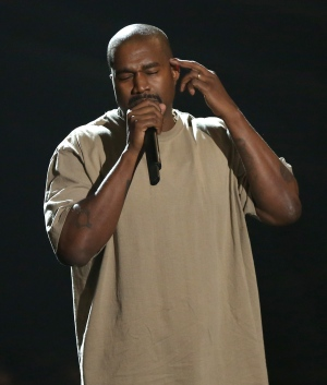 Kanye West accepts the video vanguard award at the MTV Video Music Awards at the Microsoft Theater on Sunday, Aug. 30, 2015, in Los Angeles. (Matt Sayles/Invision/AP)