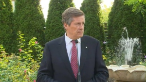 Mayor John Tory speaks with reporters on Tuesday.