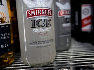 Bottles of Smirnoff Ice are seen on a cooler shelf at a store in Albany, N.Y., Monday, Jan. 28, 2008. (AP /Mike Groll)