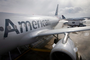 An American Airlines Flight Airbus A319 is parked at a gate at Philadelphia International Airport as a US Airways plane taxis in the background, in Exton, Pa. (Alejandro A. Alvarez/Philadelphia Daily News via AP, File)