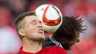 San Jose Earthquakes' Adam Jahn, right, battles for the ball with Toronto FC's Eriq Zavaleta, left, during the second half of MLS soccer action in Toronto on Saturday, May 30, 2015. (The Canadian Press/Mark Blinch)
