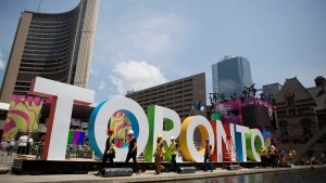 Workers erect giant letters spelling out Toronto in Nathan Phillips Square as they prepare for the Pan Am Games, Wednesday, July 8, 2015. (AP /Rebecca Blackwell)