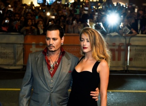 Actor Johnny Depp and wife Amber Heard pose for photographs on the red carpet for the new movie 'Black Mass' during the 2015 Toronto International Film Festival on Monday, Sept. 14, 2015. (The Canadian Press/Nathan Denette)