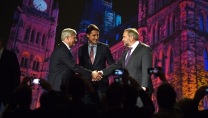 NDP Leader Tom Mulcair shakes hands with Conservative Leader Stephen Haper as Liberal Leader Justin Trudeau looks on during their introduction prior to the Globe and Mail hosted leaders' debate in Calgary on Thursday, Sept. 17, 2015. (The Canadian Press/Sean Kilpatrick)
