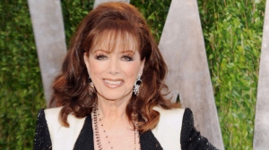 In this Feb. 24, 2013 file photo, author Jackie Collins arrives at the 2013 Vanity Fair Oscars Viewing and After Party in West Hollywood, Calif.  Collins, died in Los Angeles on Saturday, Sept. 19, 2015, of breast cancer. She was 77.  (Photo by Evan Agostini/Invision/AP, File)