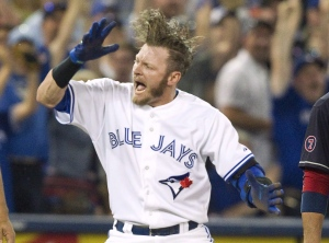 Toronto Blue Jays' Josh Donaldson celebrates after sliding safely into third base with a triple against the Cleveland Indians during fifth inning AL baseball action in Toronto on Monday, August 31, 2015. He's been called a leader, a fierce competitor, a front-runner in the American League MVP race. And with a hairstyle that's garnered massive attention over the past couple months, Donaldson can be called a trendsetter, too. THE CANADIAN PRESS/Fred Thornhill