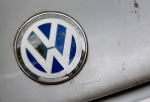 The company's logo is pictured on the hood of a Volkswagen Beetle a wrecking yard in Berlin, Germany, Wednesday, Sept. 23, 2015.  (AP /Michael Sohn)