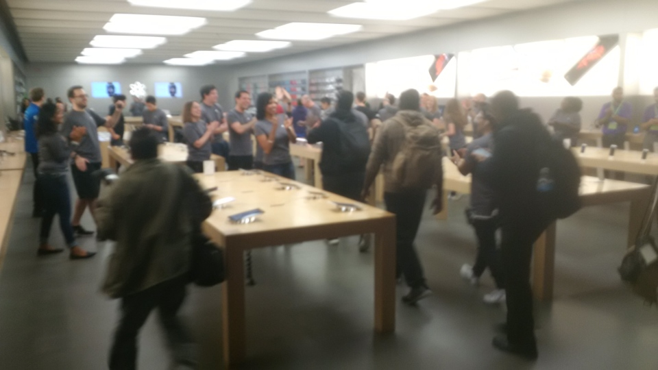 Apple fans rush into the Apple Store at the Eaton Centre as it opens to get their hands on the new iPhone 6s Friday September 25, 2015. (Cam Woolley /CP24)
