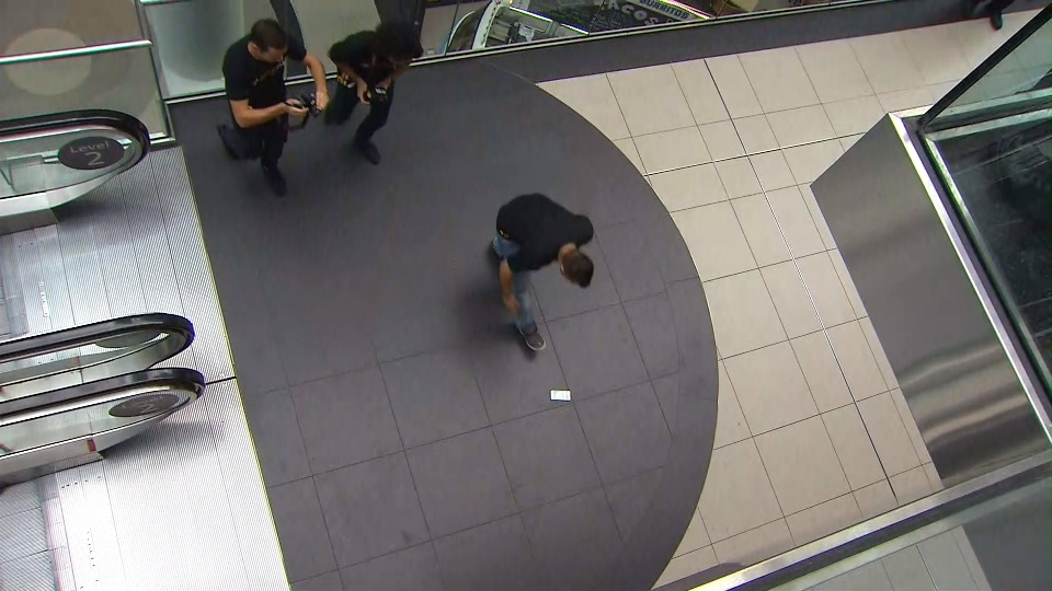 A brand new iPhone 6s is picked up off the ground after falling one floor inside Toronto's Eaton Centre on Friday morning.