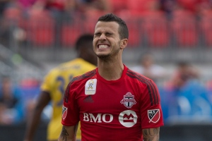 Toronto FC's Sebastian Giovinco reacts after failing to convert a goal scoring opportunity against Colorado Rapids during first half MLS action in Toronto on Saturday, September 19, 2015. THE CANADIAN PRESS/Chris Young