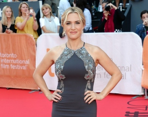 """FILE - In this Sept. 14, 2015 file photo, Kate Winslet attends the premiere for """"The Dressmaker"""" at the Toronto International Film Festival at in Toronto. Winslet also stars with Michael Fassbender in """"Steve Jobs,"""" a film about the Apple co-founder. (Photo by Evan Agostini/Invision/AP, File)"""