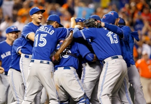 Members of the Toronto Blue Jays celebrate after winning the first baseball game of a doubleheader against the Baltimore Orioles, Wednesday, Sept. 30, 2015, in Baltimore. (AP Photo/Patrick Semansky)