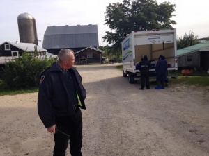 Officials from the Ontario Ministry of Agriculture and Food are seen during a search of Glencolton Farm, in Durham, Ont., in this handout photo taken by the farm operator on Friday, October 2, 2015. (Michael Schmidt /Handout)