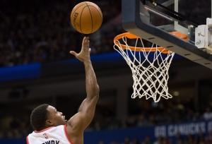 Toronto Raptors' Kyle Lowry scores against the Los Angeles Clippers during the second half of a pre-season NBA basketball game in Vancouver, B.C., on Sunday October 4, 2015. THE CANADIAN PRESS/Darryl Dyck