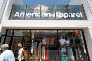 In this Wednesday, July 9, 2014, file photo, passers-by walk in front of the American Apparel store in the Shadyside neighborhood of Pittsburgh. (AP /Keith Srakocic, File)