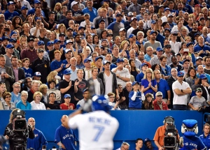 Toronto Blue Jays fans stand on their feet cheering as lead off hitter Ben Revere (7) get pitched to by the New York Yankees during seventh inning AL baseball action in Toronto on Wednesday, September 23, 2015. THE CANADIAN PRESS/Nathan Denette