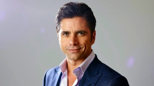 """In this Aug. 6, 2015 file photo, actor John Stamos, from the new comedy """"Grandfathered,"""" poses for a portrait during the Fox 2015 Television Critics Association Summer Press Tour in Beverly Hills, Calif.  (Matt Sayles/Invision/AP)"""