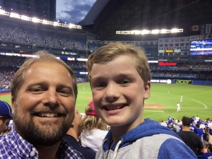Kristian Teleki and his son Luka pose for a photo as the Toronto Blue Jays play the Oakland Athletics at the Rogers Centre in Toronto on Aug. 11, 2015. (The Canadian Press/HO)