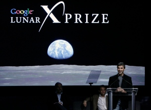 Larry Page, co-founder and President of Products at Google, right, speaks as Bob Weiss, left, and Dr. Peter Diamandis sit on stage at WIRED NextFest Thursday, Sept. 13, 2007, in Los Angeles. (AP /Ric Francis)