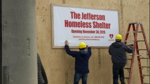A sign was placed on a building in Leaside indicating that a homeless shelter was coming to the neighbourhood as part of a stunt to raise awareness about homelessness. (Photo supplied by Raising the Roof)