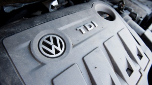 A Volkswagen Touran with the 2.0l TDI EA189 type Diesel engine, one of the engines named in the Volkswagen scandal involving manipulated data in emissions tests, in Sehnde, Germany, 03 October 2015. Volkswagen customers may enter their vehicle identification number on a website of the company to verify if their car is one of the models affected by the scandal.  (EPA/JULIAN STRATENSCHULTE)