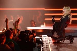 Pop superstar Madonna performs at the Xcel Energy Center in St. Paul, Minn. on Thursday, Oct. 8, 2015. (John Autey/Pioneer Press via AP)
