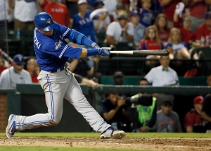 Toronto Blue Jays shortstop Troy Tulowitzki (2) makes a three-run home run against the Texas Rangers during the sixth inning in Game 3 of baseball's American League Division Series Sunday, Oct. 11, 2015, in Arlington, Texas. (AP Photo/Tony Gutierrez)