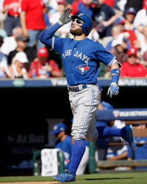 Toronto Blue Jays center fielder Kevin Pillar (11) scores a home run against the Texas Rangers in the second inning in Game 4 of baseball's American League Division Series Monday, Oct. 12, 2015, in Arlington, Texas. (AP Photo/Tony Gutierrez)