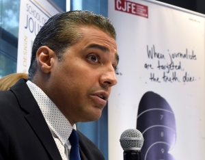 Canadian journalist Mohamed Fahmy addresses a news conference hosted by Canadian Journalists for Free Expression while his wife Marwa Omara looks on at Ryerson University in Toronto on Tuesday, Oct. 13, 2015. (The Canadian Press/Frank Gunn)