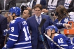 Toronto Maple Leafs head coach Mike Babcock stands behind the bench as his team plays the Montreal Canadiens during second period NHL action in Toronto on Wednesday, Oct. 7, 2015. Babcock brought his system to the Toronto Maple Leafs and spent training camp teaching players all about it. Three games into the season, there's plenty to work on as the coach and the Leafs continue to go through a feeling-out process with each other.THE CANADIAN PRESS/Frank Gunn