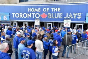 Fans arrive for game one of the Toronto Blue Jays and Texas Rangers American League Division Series in Toronto on Thursday, Oct.8, 2015. THE CANADIAN PRESS/Nathan Denette