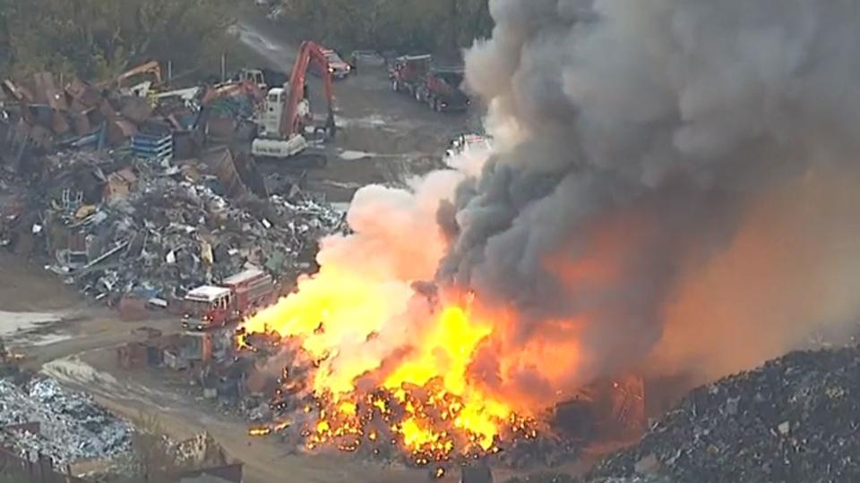 A massive fire burns at a scrapyard in Stouffville Thursday, October 15, 2015.