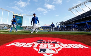 Toronto Blue Jays players walk to the dugout after batting practice before Game 2 of baseball's American League Championship Series against the Kansas City Royals on Saturday, Oct. 17, 2015, in Kansas City, Mo. (AP Photo/Paul Sancya)