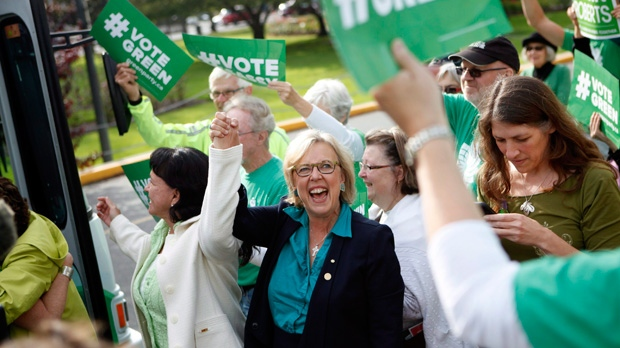 Green Party leader Elizabeth May, arrives by bus during a campaign rally to speak to supporters during the final stop of her three-day Vancouver Island bus tour in Victoria, B.C., Sunday, October 18, 2015. THE CANADIAN PRESS/Chad Hipolito