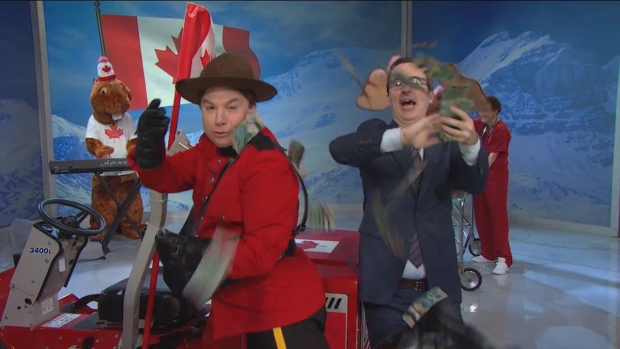 Late-night television personality John Oliver, right, and Canadian-born actor Mike Myers throw five thousand dollars of Canadian bills at the camera during a segment of an episode of Last Week Tonight, on Oct. 18, 2015, which dealt with the Canadian federal election. (The Canadian Press/HO-YouTube)