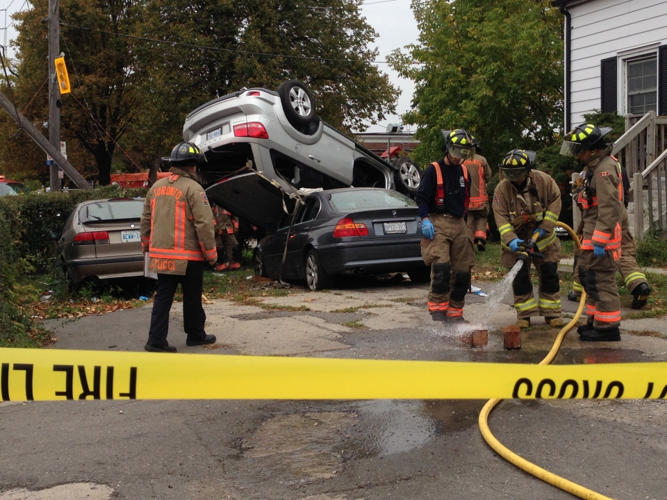 A vehicle is seen resting atop another following a crash in Toronto's Downsview neighbourhood on Wednesday, Oct. 21, 2015. (CTV/Ted Brooks)