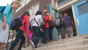 Children enter a school in this file photo.