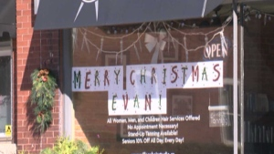 A Christmas sign is pictured in a store window in St. George, Ont. Saturday, October 24, 2015.
