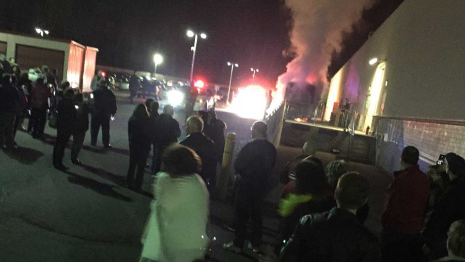A tour bus burns outside a Moncton venue where Whoopi Goldberg was performing Saturday October 24, 2015.
