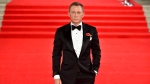 Actor Daniel Craig who, portrays James Bond attends the World Premiere of the new James Bond movie Spectre, held at the Royal Albert Hall in London Monday, Oct. 26, 2015. (Matt Crossick/PA via AP)