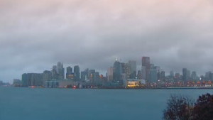 Clouds cover part of the Toronto skyline on Wednesday, Oct. 28, 2015.