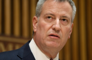 "In this Oct. 21, 2015 file photo, New York City Mayor Bill de Blasio speaks during a media briefing in New York. De Blasio, a Democrat, announced during a Friday, Oct. 30, 2015 appearance on MSNBC's ""Morning Joe"" that he's backing Hillary Rodham Clinton for president. He called her the best candidate to address income inequality.(AP Photo/Seth Wenig)"