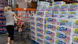 In this June 13, 2011 photo, shoppers buy toilet paper at Costco in Mountain View, Calif. (AP Photo/Paul Sakuma)
