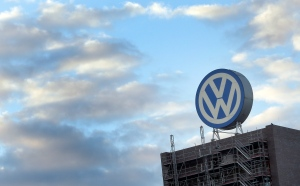 In this Sept. 26, 2015 file photo a giant logo of the German car manufacturer Volkswagen is pictured on top of a company's factory building in Wolfsburg, Germany. (AP /Michael Sohn)