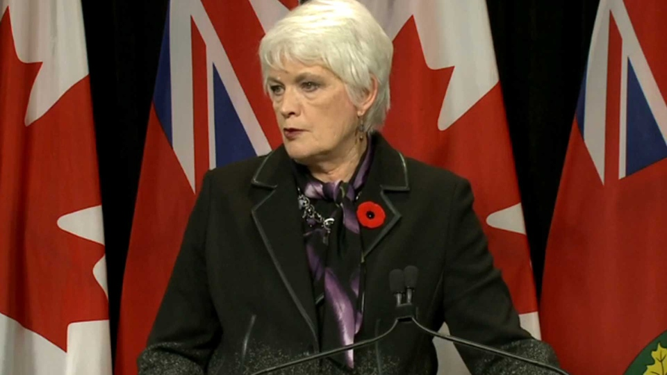 Education Minister Liz Sandals speaks with reporters at Queen's Park Monday November 2, 2015.
