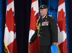Chief of Defence Staff Gen. Jonathan Vance (right) arrives for a change of command ceremony in Ottawa on July 17, 2015. THE CANADIAN PRESS/Adrian Wyld