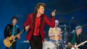 In this July 4, 2015 file photo, Ronnie Wood, Mick Jagger, Charlie Watts and Keith Richards of the Rolling Stones perform at the Indianapolis Motor Speedway in Indianapolis. (Barry Brecheisen/Invision/AP)