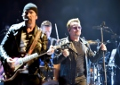 In this Sept. 4, 2015, file photo Bono, right, leader of Irish rock band U2, performs in Turin, Italy. (Alessandro Di Marco/ANSA via AP)